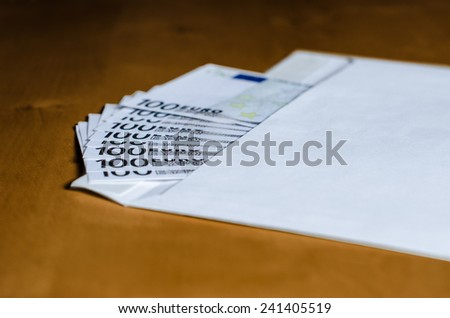 euros in envelope on the table - stock photo