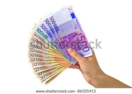 Euros in hand at white background - stock photo
