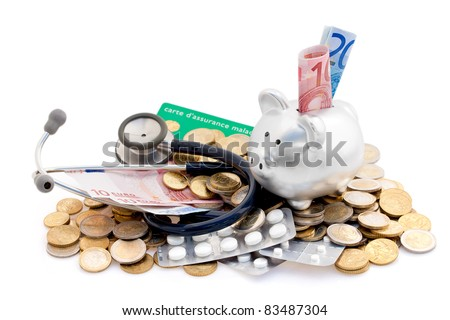 Euros, stethoscope, piggy bank and pills - metaphor for the soaring cost of medical care. - stock photo