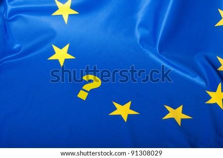 Euroscepticism - Detail of Silky Flag of Blue European Union EU Flag Drapery With Question Mark - stock photo