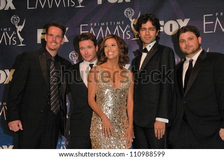 "Eva Longoria and the cast of ""Entourage"" in the press room at the 59th Annual Primetime Emmy Awards. The Shrine Auditorium, Los Angeles, CA. 09-16-07"
