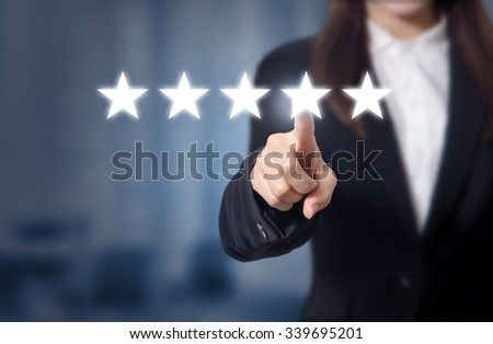 evaluation concept. Businesswoman pointing five star to increase rating of company, Increase rating. - stock photo