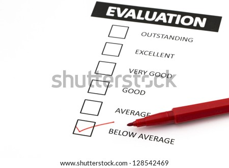 Evaluation form with a tick placed in below average check-box. - stock photo
