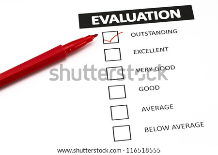 Evaluation form with a tick placed in Outstanding check-box. - stock photo