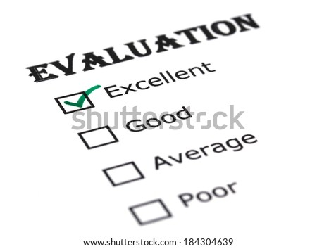 Evaluation paper checked with green ink - stock photo