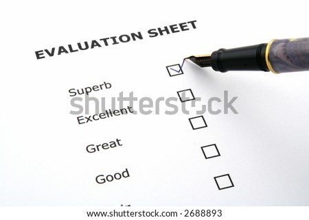 evaluation sheet with a pen and a box ticked - stock photo