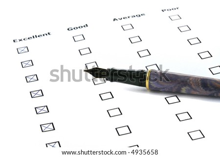 evaluation sheet with excellent boxes crossed - stock photo
