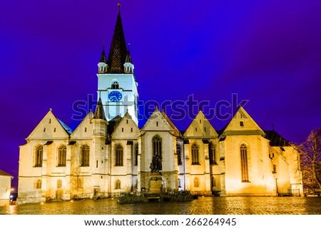 Evangelic cathedral church in Sibiu, Transylvania, Romania at night - stock photo