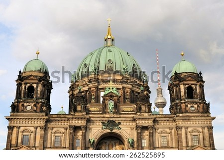 Evangelical neo-renaissance cathedral - Berliner Dom - on Museum Island with TV Tower in the background in Berlin, Germany