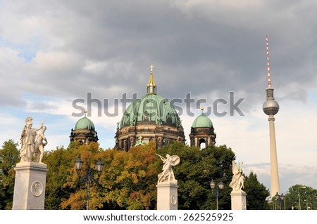 Evangelical neo-renaissance cathedral - Berliner Dom - on Museum Island with TV Tower in the background in Berlin, Germany - stock photo