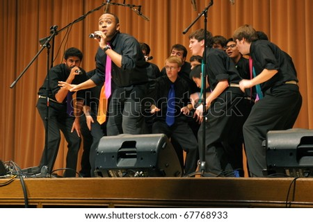 EVANSTON, ILLINOIS- NOVEMBER 13: An a cappella singing group The Stereotypes of Washington University performs in The Best of the Midwest Concert on November 13, 2010 in Evanston, Illinois. - stock photo