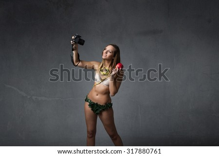 eve taking selfie with reflex, textured background - stock photo