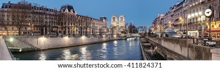 Eveing panorama of illuminated Paris with Notre-Dame cathedral