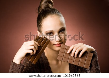 Even more chocolate, gorgeous young brunette girl with severe chocolate cravings. - stock photo