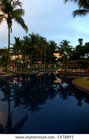 Evening at a city resort poolside - stock photo