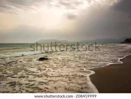 Evening at the windy beach - stock photo