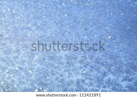 evening blue frost pattern texture on the glass - stock photo