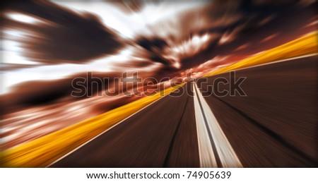 Evening blurred asphalt road - stock photo
