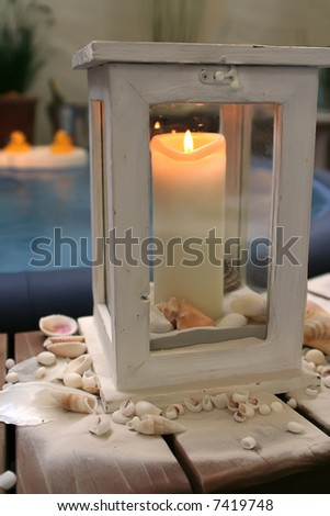 evening candle by outside of spa bath - stock photo