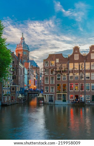 Evening city view of Amsterdam canal, bridge and typical houses, Holland, Netherlands. Long exposure. - stock photo