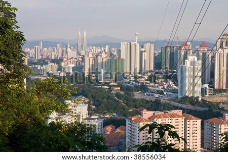 Evening cityscape of Kuala Lumpur city from a hill - stock photo