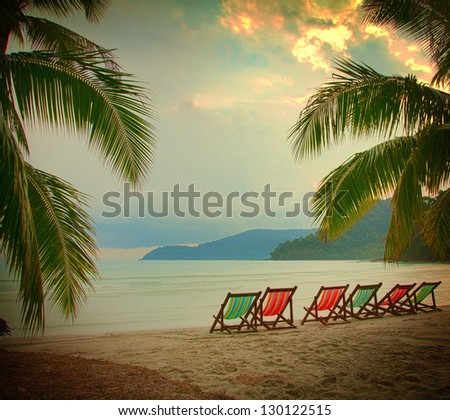 Evening clouds over luxury beach - stock photo