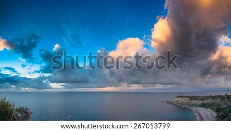 Evening cloudscape on the Milazzo cape, nature reserve Piscina di Venere, Sicily, Italy, Tyrrhenian sea, Europe. - stock photo
