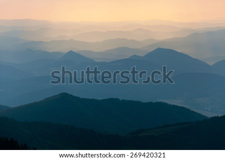 Evening colored view of blue horizons - view from Mala Fatra mountains to Beskyd or beskydy mountains - Karpathos mountains - Europe - stock photo