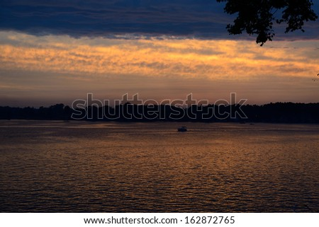 Evening colors and clouds over Lake James in Angola, Indiana USA. - stock photo