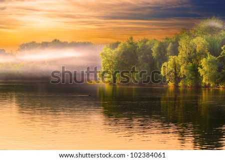 Evening Dnieper river covered with haze - stock photo