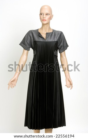 Evening dress on a dummy isolated on a background - stock photo