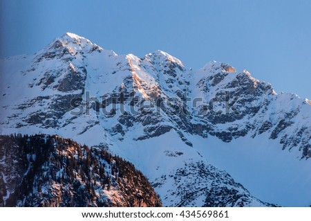 Evening falls over the mountain-range in Austria. - stock photo