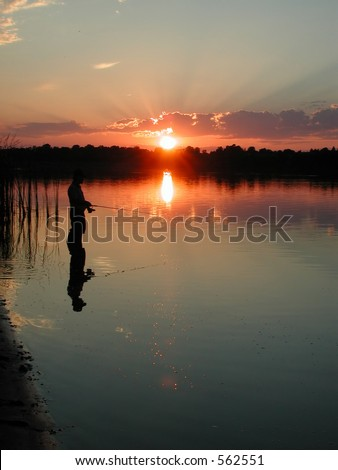 evening fishing on the river - stock photo