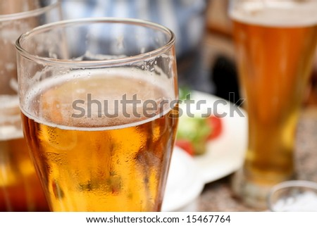 evening glass of light beer with friends - stock photo