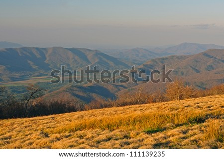 Evening Haze on Gregory Bald looking at Cades Cove in The Smoky Mountains - stock photo