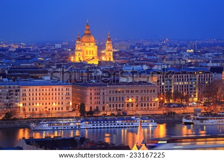 Evening image of the dome of St Stephen church across Danube river and Budapest roof tops, Hungary - stock photo