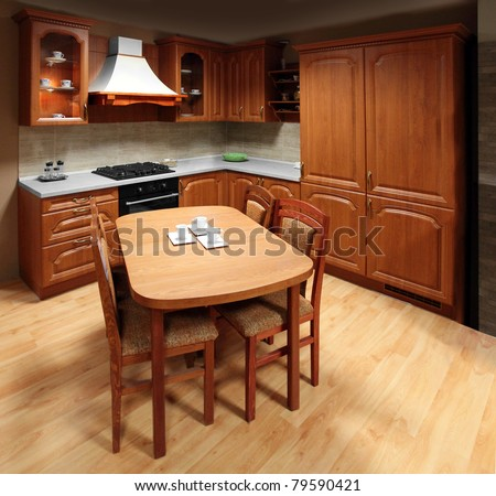 Evening in beautiful kitchen and dinning room. - stock photo