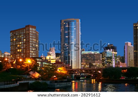 Evening in Chicago. Skyscrapers and reflections. - stock photo