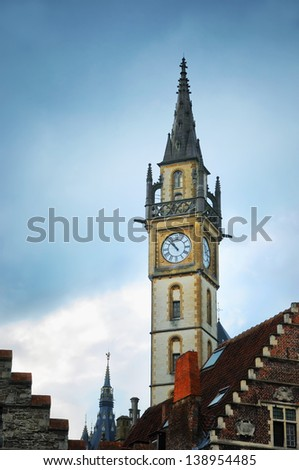 Evening in Gent, Belgium with view ofclock tower - stock photo