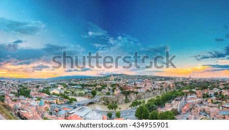 Evening In Tbilisi At Sunset, Georgia. On Photograph Visible The Bridge Of Peace, A New Concert Hall, Presidential Administration, Holy Trinity Cathedral, Metekhi And Historic District Abanotubani. - stock photo