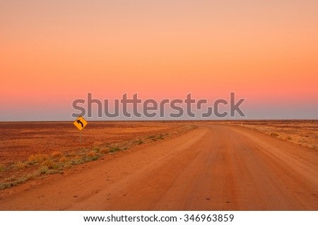 Evening in the Australian Outback, dirt road near Coober Pedy - stock photo