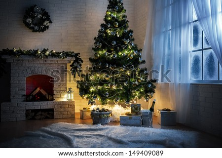 Evening interior with elegant Christmas tree and fireplace - stock photo