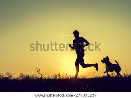 Evening jogging with beagle pet - stock photo