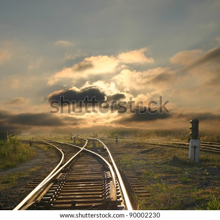 evening landscape with railroad rails - stock photo