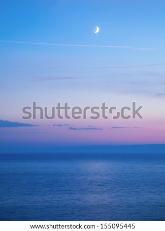 Evening landscape with sea and moon - stock photo