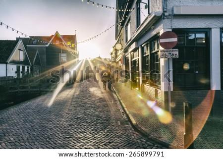 evening light, dutch old village in Amsterdam region, Volendam. added noise - stock photo