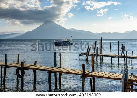Evening light on Lake Atitlan & San Pedro volcano in Guatemalan highlands - stock photo
