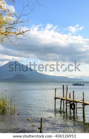 Evening light on Lake Atitlan & Toliman volcano, Guatemala. - stock photo
