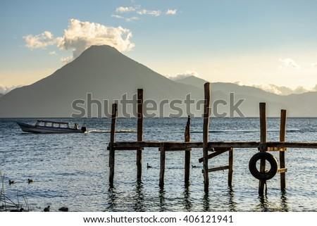 Evening light on Lake Atitlan with San Pedro volcano behind in Guatemalan highlands - stock photo