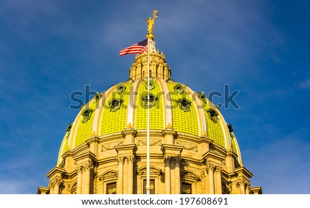 Evening light on the dome of the Pennsylvania State Capitol in Harrisburg, Pennsylvania. - stock photo